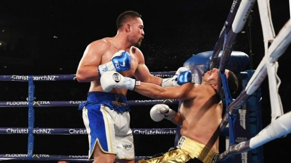 Parker lands a left hook on Flores against the rope in their Saturday bout.